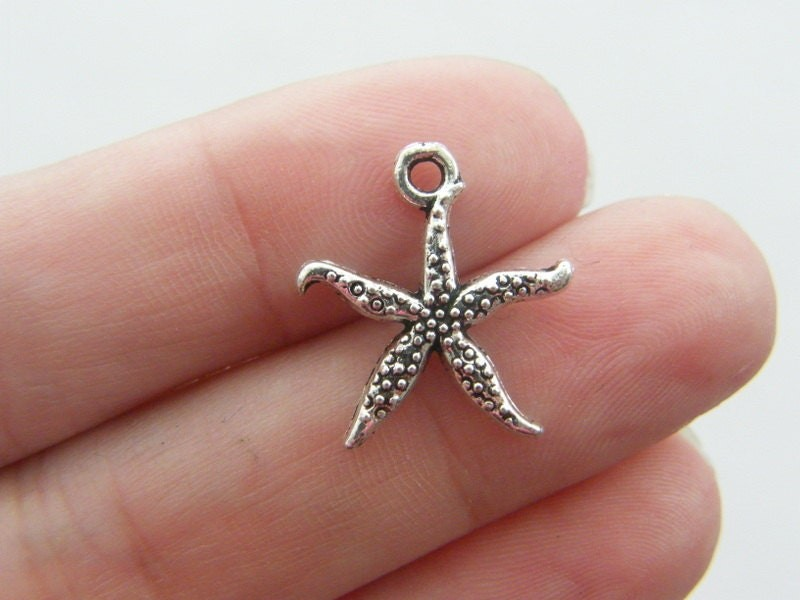 10 Starfish charms antique silver tone FF201