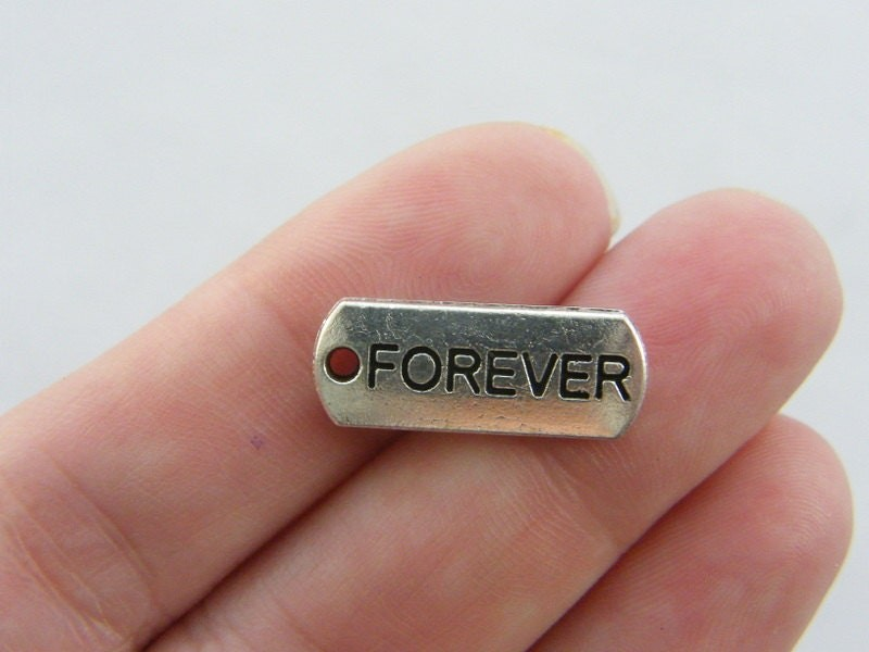 10 Forever charms antique silver tone M57