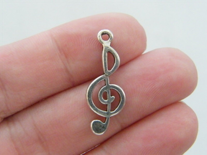 BULK 50 Music note charms tibetan silver MN14