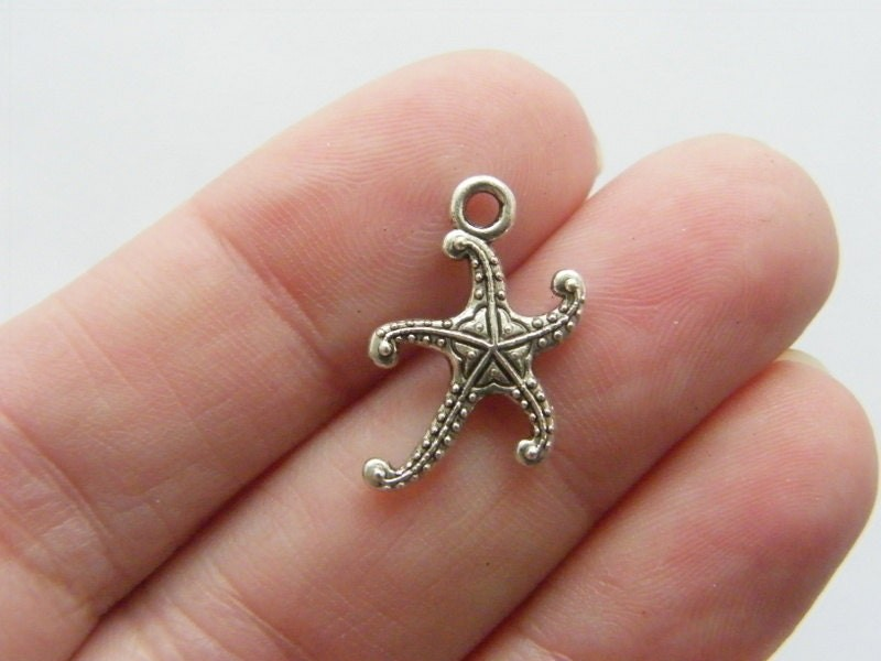 8 Starfish charms antique silver tone FF240