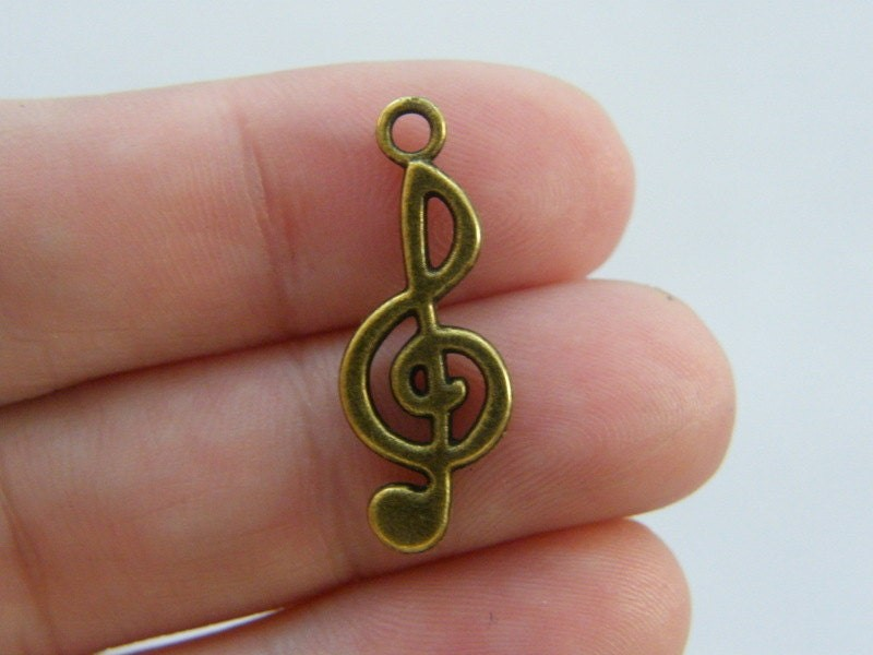 12 Music note charms antique bronze tone BC191