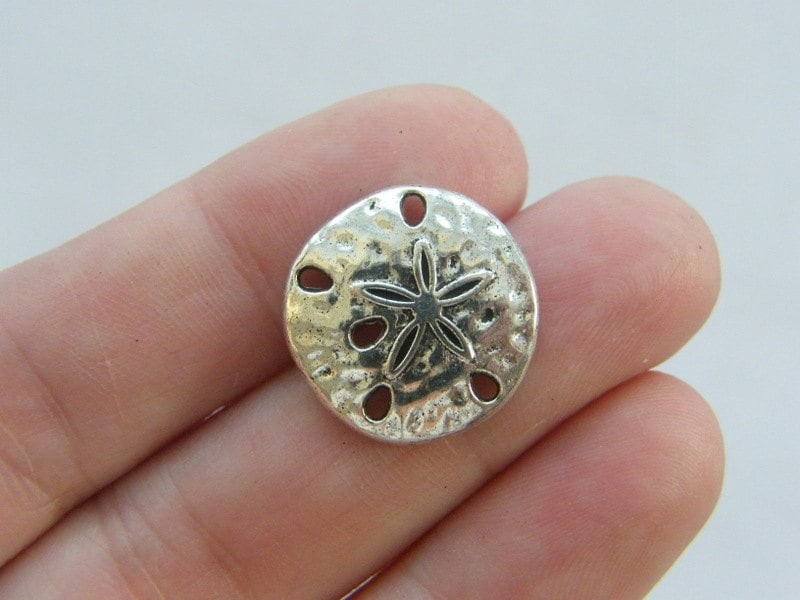 8 Sand dollar charms antique silver tone FF222