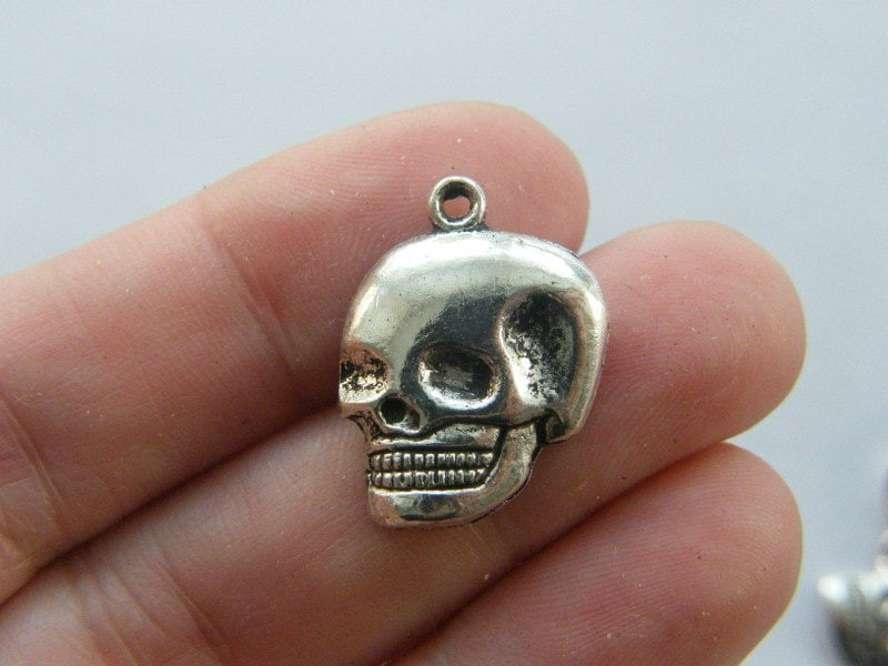 BULK 50 Skull charms antique silver tone HC315