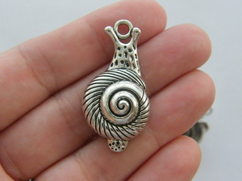 4 Snail charms antique silver tone A297