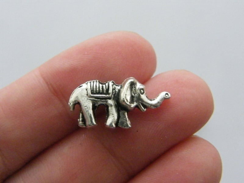 8 Elephant spacer beads antique silver tone A524