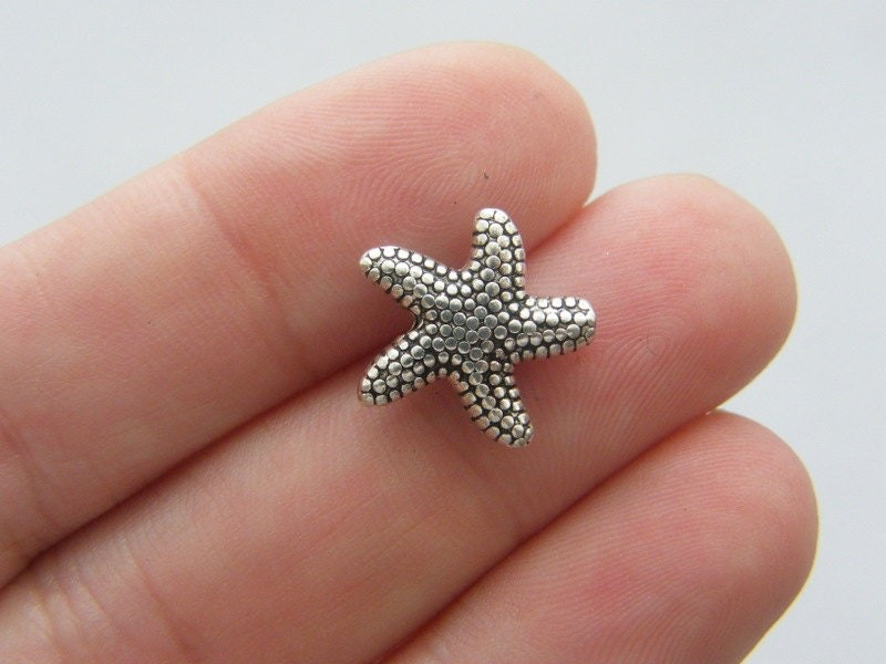 8 Starfish spacer beads antique silver tone FF197
