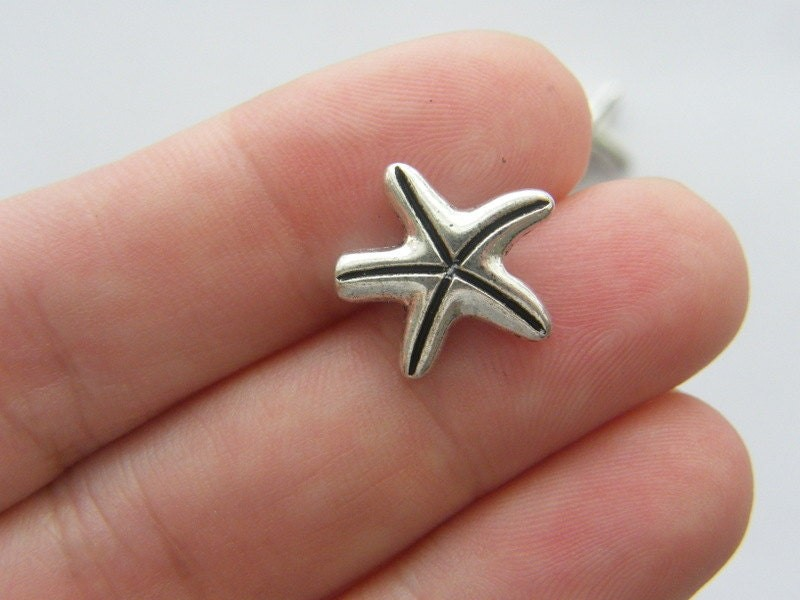 BULK 50 Starfish spacer beads antique silver tone FF225