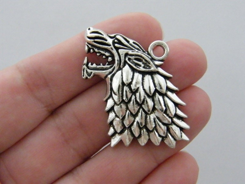 4 Wolf charms antique silver tone A273