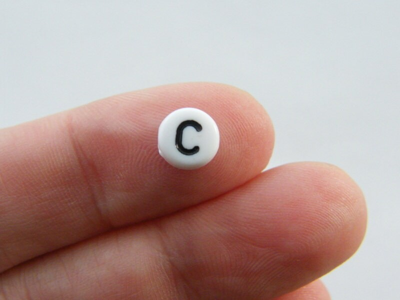 100 Letter C acrylic round alphabet beads white and black