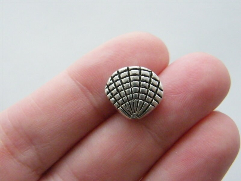 10 Shell spacer beads antique silver tone FF239