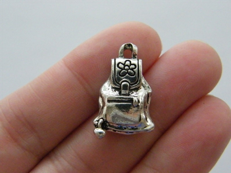 2 Backpack charms antique silver tone CA186