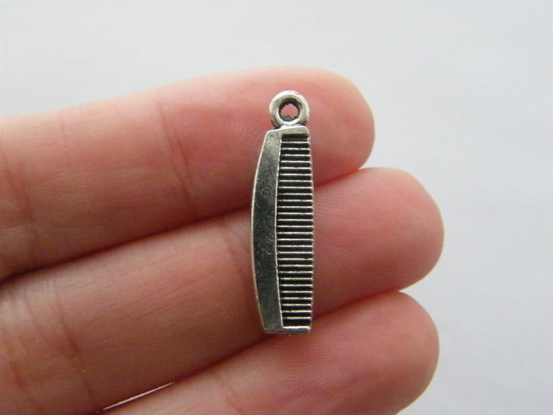 8 Comb charms antique silver tone P360