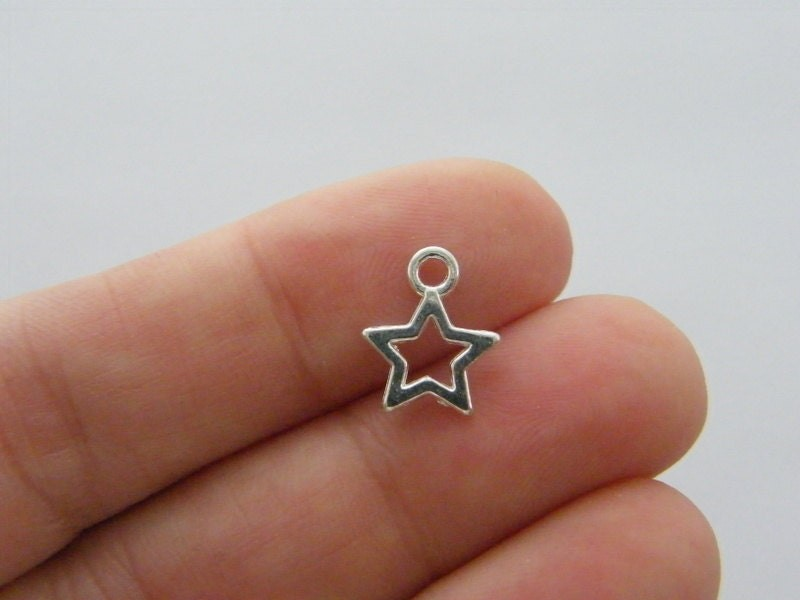 14 Star charms silver plated tone S128