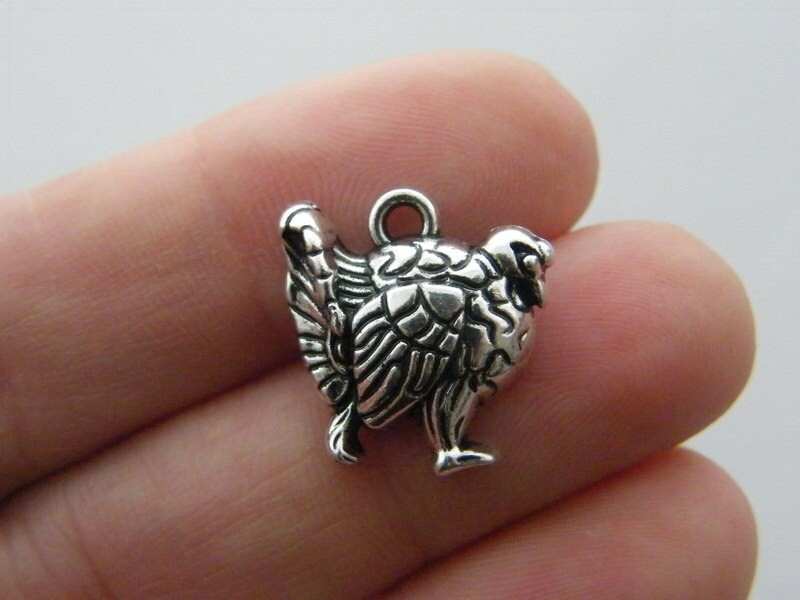 4 Turkey charms antique silver tone B153